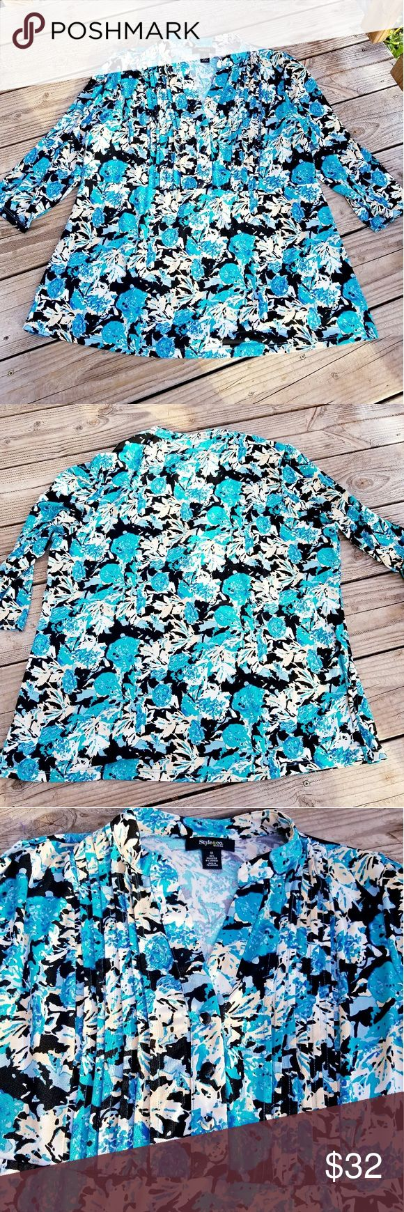 """Teal & Aqua Floral Plus Sized Blouse I think it's more like a 2X. Gorgeous colors! Teal, turquoise, aqua, black, white, & beige. Has pretty button & bust details. Kind of a ribbed ripple effect from the shoulder line to the under bust. Creates kind of a babydoll effect. The material is super stretchy & heavier than expected. Bust-48-52"""". Waist- Stretches to 44"""", but to fit more like a babydoll, the max waist measurement should be closer to 36"""". Hips Stretches to 52, but to fit loosely the…"""