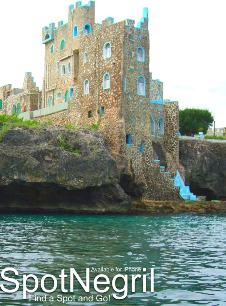 Blue Cave Castle hotel in Negril, Jamaica from a glass bottom boat.