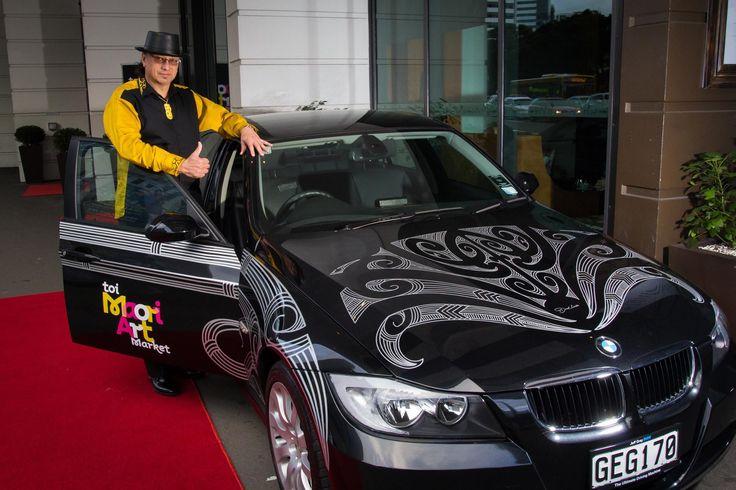 Derek Lardelli with his designs on the BMW.