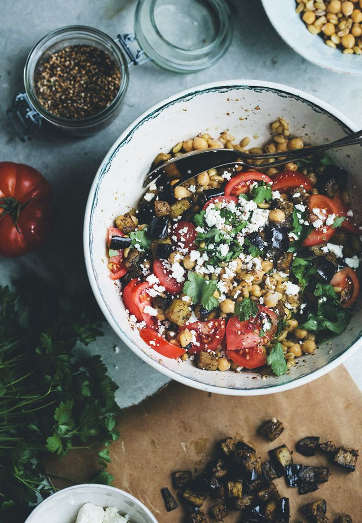 (chickpeas, wheat berries, sumac grilled aubergine, juicy  tomatoes, parsley and goat's cheese. drizzled with olive oil, lemon and an amazing za'atar blend)----chickpea za'atar salad via Green Kitchen Stories