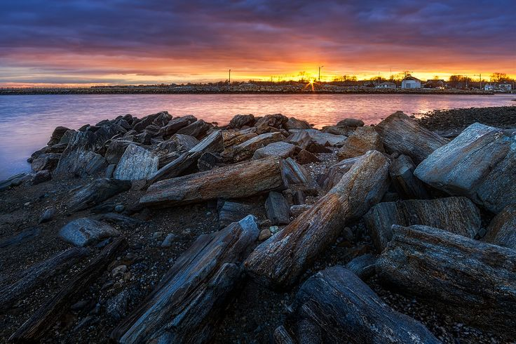 Sunset on the rocks at St Mary's By The Sea in Bridgeport, Connecticut, USA. More images on my blog .. www.lbsimmsphotography.blogspot.com