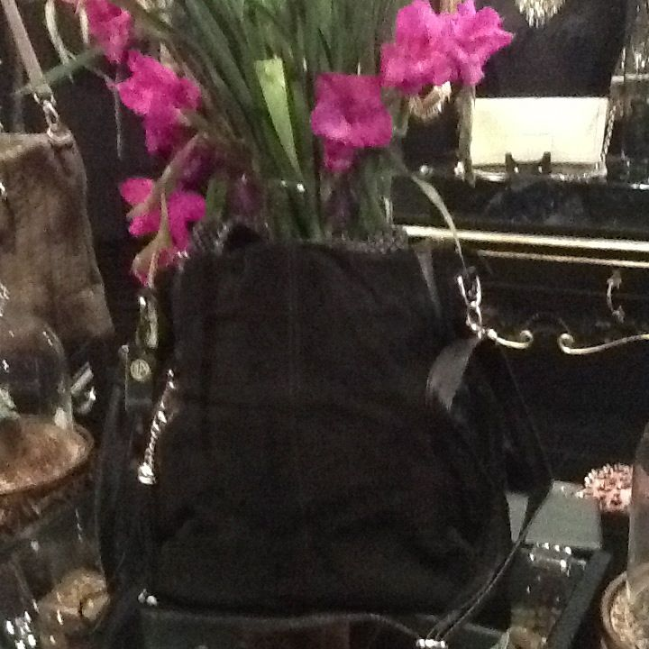 Great leather and suede bags at Mara Cino drop in and see them