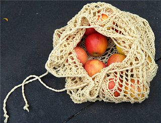 """The inspration for this Market Bag came from the Ravelry Designer's Challenge with the theme of """"spring awakening""""."""