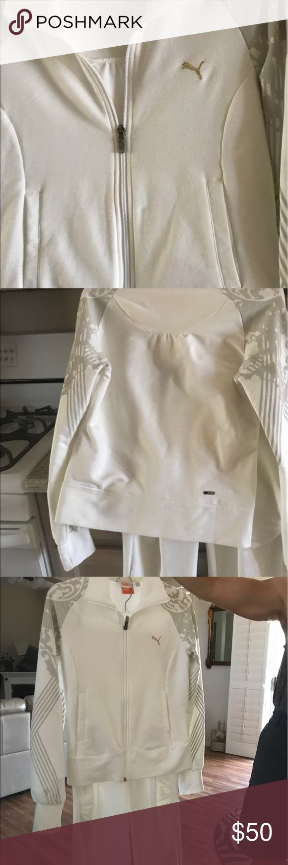 Jogging outfit White jogging outfit just beautiful yes please on the knees which is sharp never seen before was a gift it's too small for me  .this is a color that is so awesome when you wear it he can't be missed. Puma Other