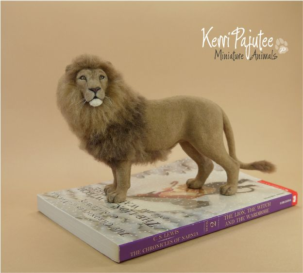 A one-off, static sculpture of contemplative African lion ~by hand using blended polymer clay over a wire armature. After curing, lion was detailed ...