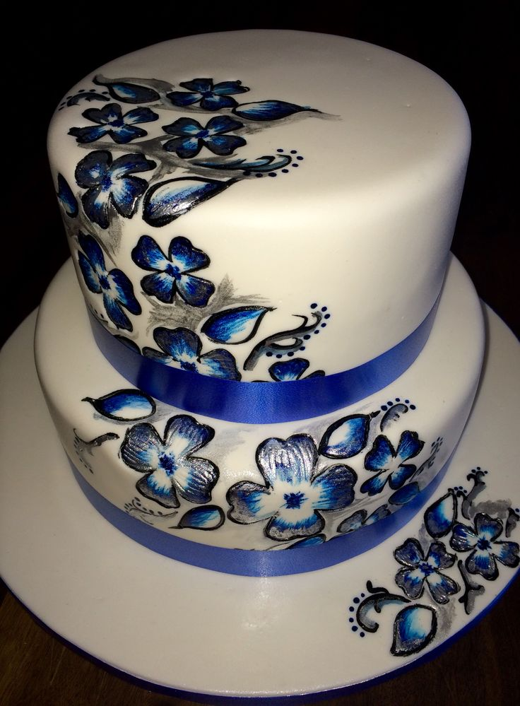 Hand painted wedding cake in blue, white and silver