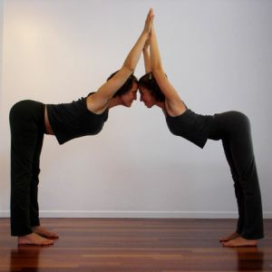 8 Partner Yoga Poses for Friends and Lovers-This Valentine's Day, forget the chocolate and flowers. Spend some time together connecting with your favorite person by doing some partner yoga.