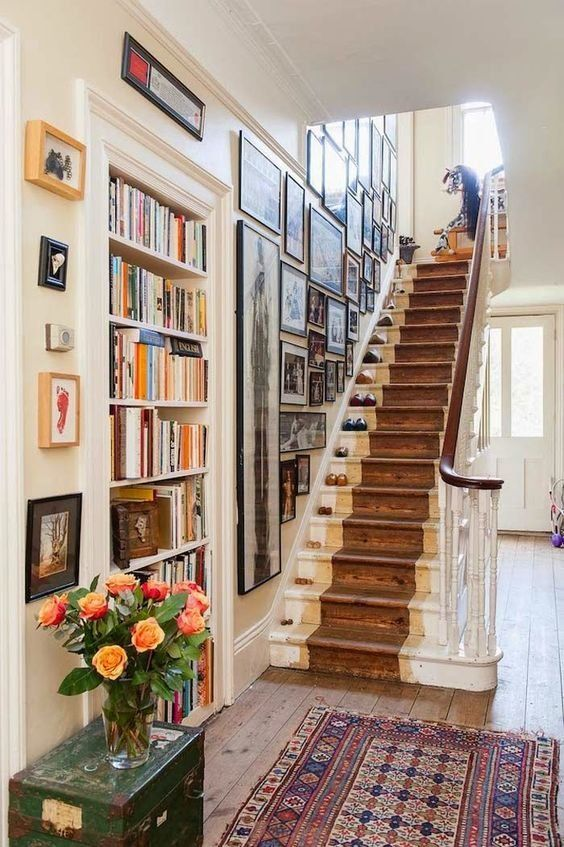 Dreamy staircase with gallery wall and bookshelves. What's not to love. Entryway. Hallway. Stairs.