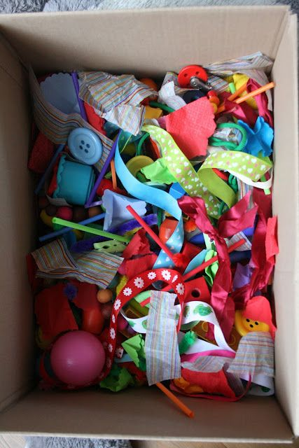 The Imagination Tree: Baby Play Ideas and Activities: 6-18 Months. * This box is filled with choking hazards.  I would substitute the buttons and straws for infant sized toys.  Maybe scour SAVERS.  Cute idea though.
