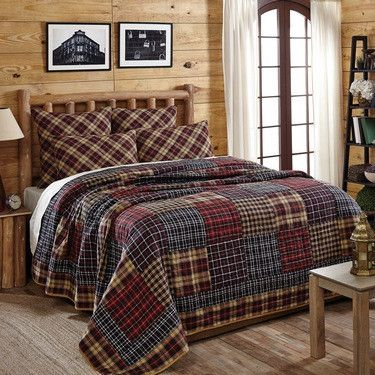 Display a simple, rustic style in your bedroom when you add this Austin patchwork king quilt from Primitive Star Quilt Shop to your bed.