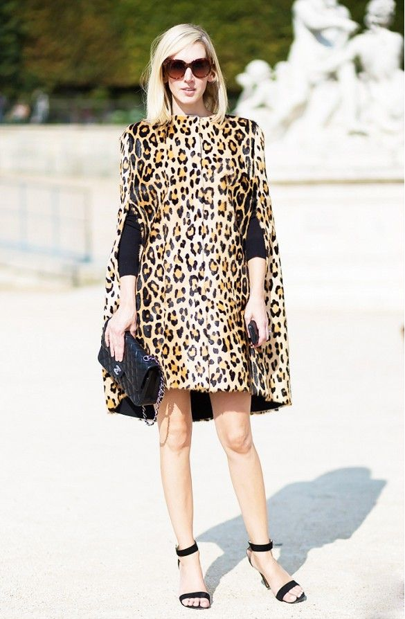 Leopard cape like dress, black strappy heels, and black handbag