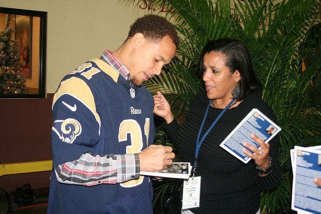 Rams player Cortland Finnegan signs autographs for fans. Taste of the NFL 135 by St. Louis Area Foodbank, via Flickr @Taste of the NFL @St. Louis Rams