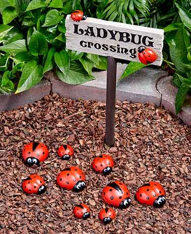 """Add an uplifting look to your garden withenchanting ladybug-themed decor.Place the Ladybug Crossing Sign (8""""W x 15-1/2""""L, including the 3"""" ground st"""