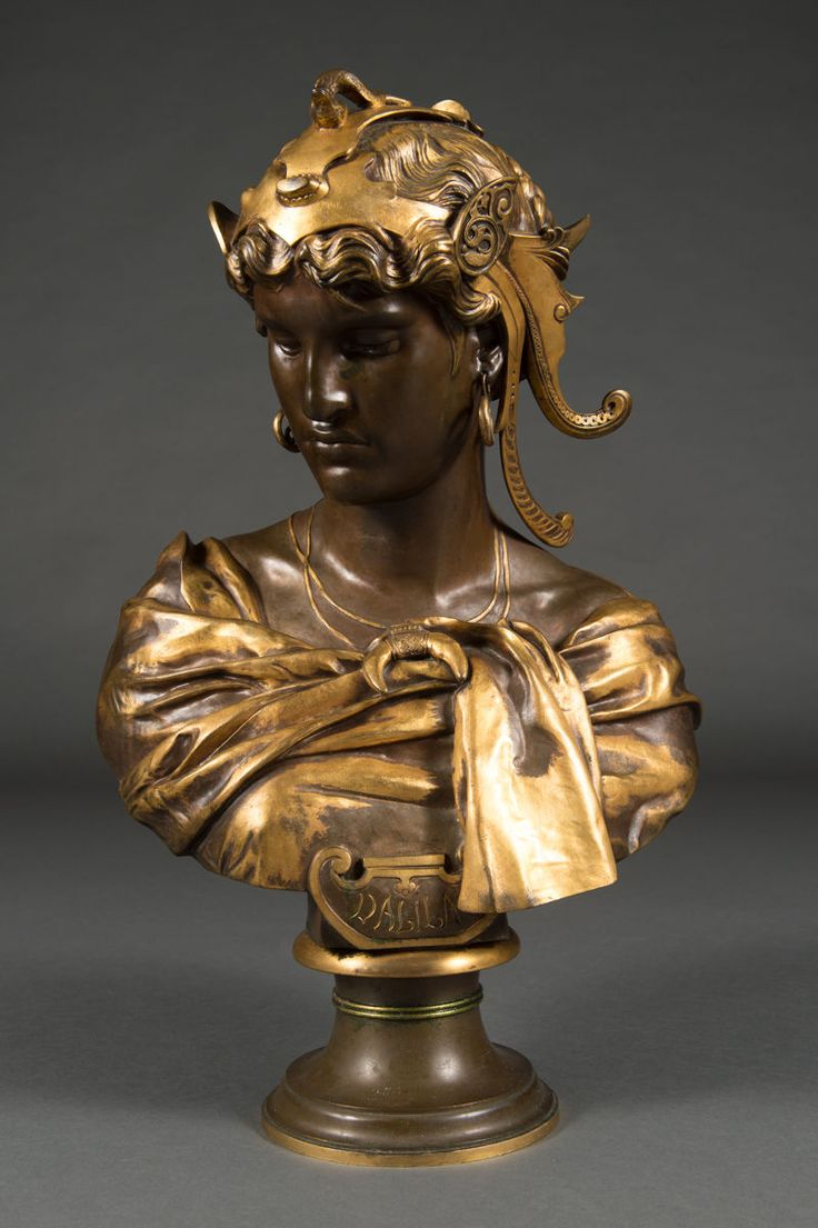 """Signed on bottom of bust """"Mercie, Rome, 1871"""" and marked by foundry """"F. Barbedienne, Fondeur"""". A Fine French Antique Patinated Bronze Bust of Delila by Antoine Mercie. """"Dalila"""", cast bronze with gold painted highlights, titled on front DALILA. 