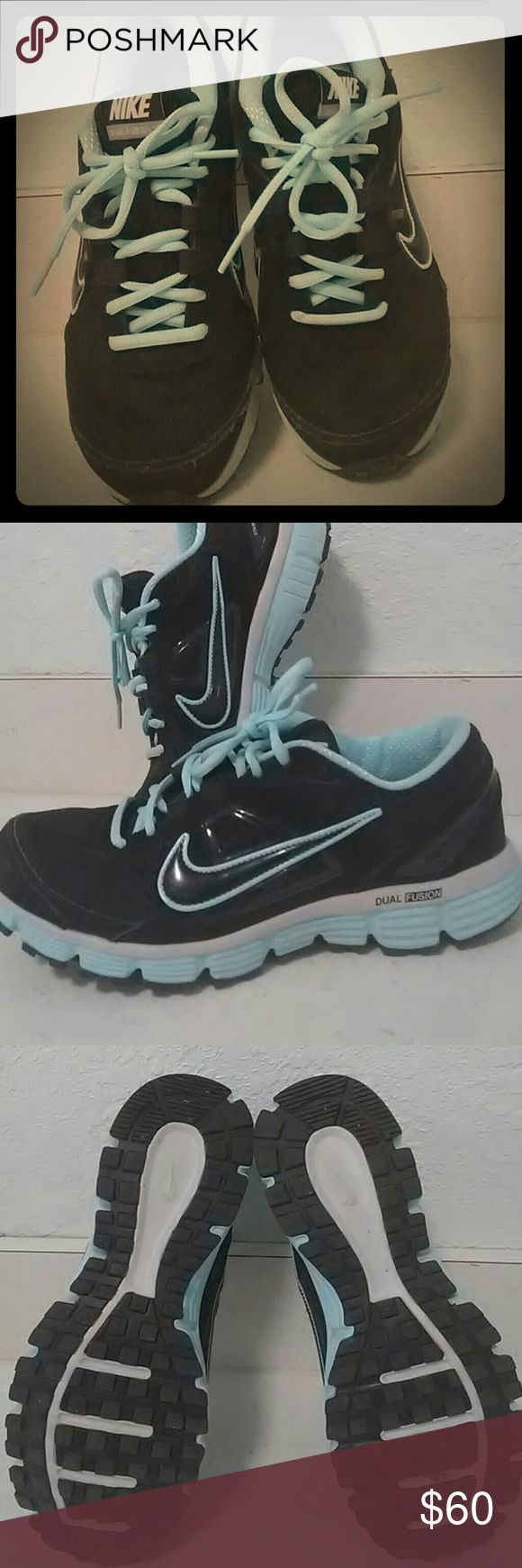 New Nikes Dual Fusion Nikes. Black and tourquoise blue. Worn a few times...love them but have sooo many pairs that I wear more often. These are super cute!!!! Nike dual fusion Shoes Athletic Shoes