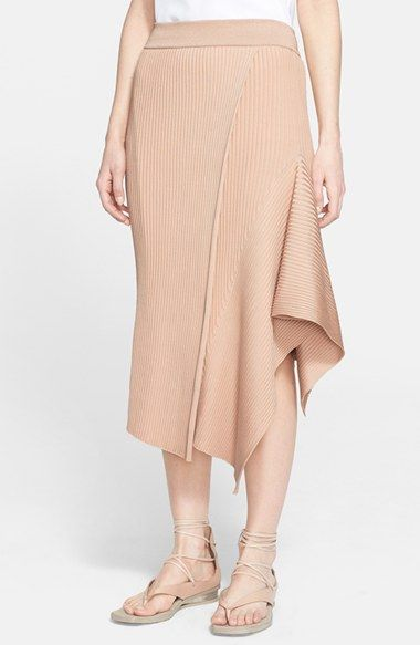 Free shipping and returns on Stella McCartney Ribbed Side Drape Midi Skirt at Nordstrom.com. A powdery neutral hue softens the aesthetic of a ribbed midi-length skirt designed with overlapping panels and a folded drape creating one-sided volume.