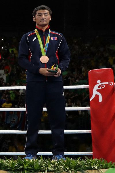 Bronze medalist Otgondalai Dorjnyambuu of Mongolia stands on the podium during the medal ceremony for the Men's Light (60kg) boxing event on Day 11 of the Rio 2016 Olympic Games at Riocentro - Pavilion 6 on August 16, 2016 in Rio de Janeiro, Brazil.