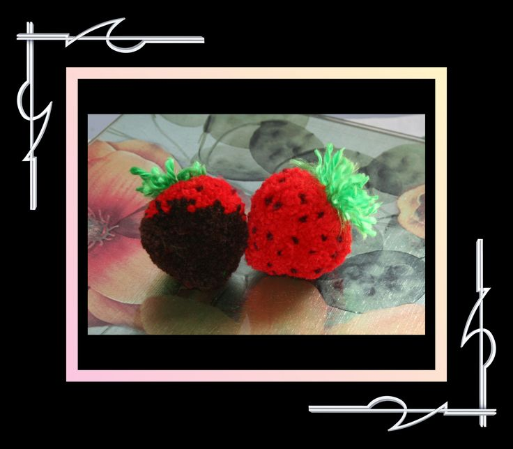 Sculptured Yarn (pompom) duo - a strawberry and a chocolate dripped strawberry. Available at thatissocool.ca