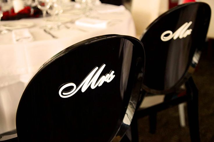 Mrs and Mr plexi signs on Kartell plexi chairs