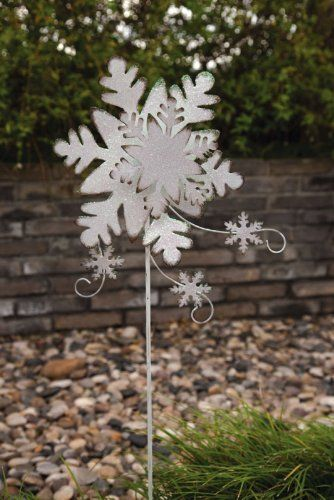 "Snowflake Garden Stake by Outdoor Decor. $14.99. 10""L x 1""W x 35""H. A festive holiday decoration. Beautiful Christmas accent piece. Silver. As if magically fallen from the sky, this brilliant silver snowflake is eye-catching. Wisps of curling wind carry smaller snowflakes along with it, creating an accent piece that celebrates the cold weather season. Perfect for your winter yard or garden, this stake will catch the attention of every friend and neighbor who stops by."