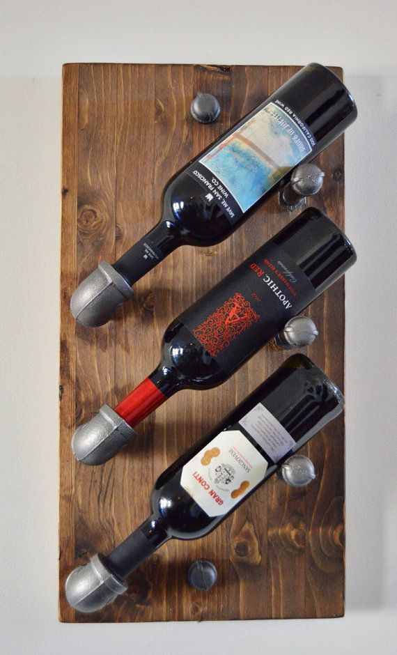 industrial 3 bottle wine rack made with plumbing pipe
