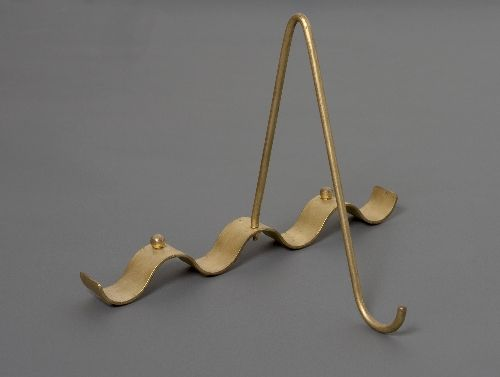 Jean ROYÈRE (1902-1981) Ondulation, model, circa 1950 Picture Holder, Constructed of gold painted metal  Editions SA 15 x 10 x 10.5 in. - 38 x 25.5 x 26.5 cm.