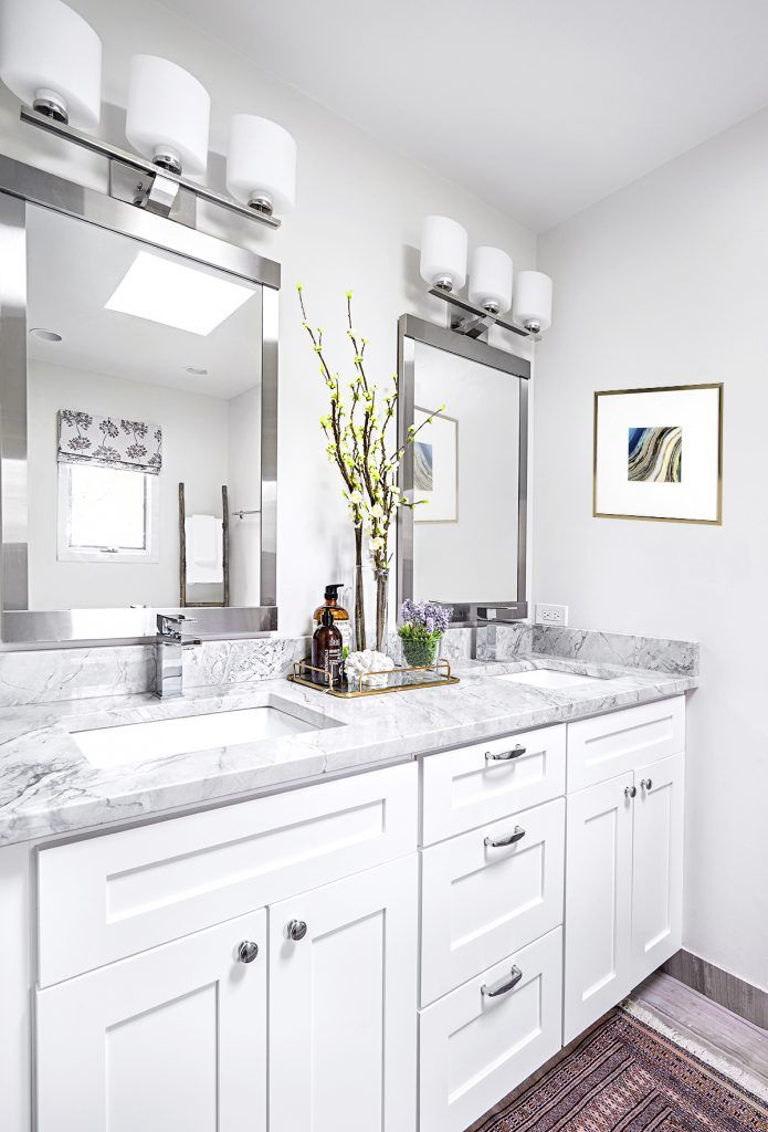 A Contemporary First Home for a Growing Family | Interior Design by Brooke Lang of Brooke Lang Design | Photography by Marcel Page | Modern Sanctuary | Bathroom | Bathroom Inspiration | White Bathroom | Contemporary Bathroom | Mirrors | Modern Mirrors | Bath Fixtures | Modern Bath Fixtures | Lighting | Contemporary Lighting