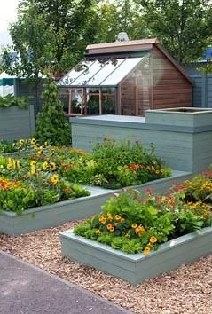 Neat raised beds- painting the beds in a gray, black or blue gray gives the garden a polished look.