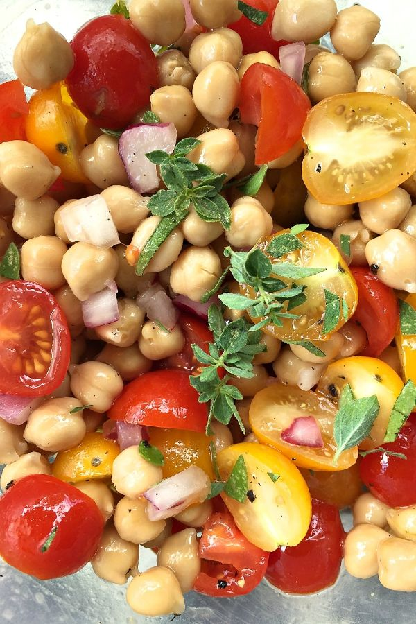 This Summer Garbanzo Tomato Salad is delightful to enjoy or serve to guests any time of year, but especially with fresh garden tomatoes and fresh herbs.