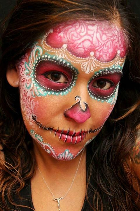Sugar skull with delicate lace stencilling I look the natural look of this one instead of the white makeup.