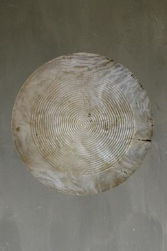 REINTERPRETED SONG WHEEL - UNIQUELY CARVED ON TWO SIDES FOR USE AS ROOM DIVIDER. SET ON STURDY SWIVEL STAND