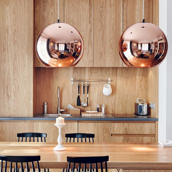 These Tom Dixon copper pendants are so beautiful. I´d hope to have them above our future dining table one day.