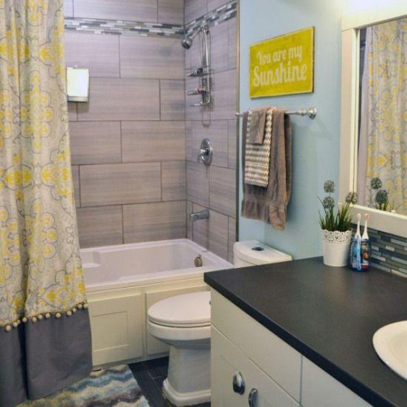Yellow Grey Aqua Bathroom A Kids Bathroom Design Featuring A Yellow Grey And Aqua Colour Combo Diy Drapes Han Bathroom Kids Yellow Bathrooms Bathroom Decor