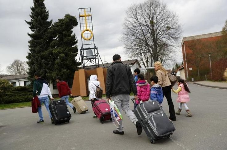 Number of migrants claiming benefits in Germany surges by 169 percent - Syrian refugees arrive at the camp for refugees and migrants in Friedland, Germany April 4, 2016. REUTERS/Kai Pfaffenbach