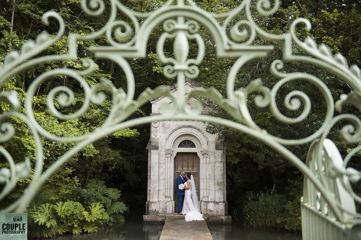 On the walkway at the chapel at Cliff at Lyons. Weddings by Couple Photography. www.couple.ie