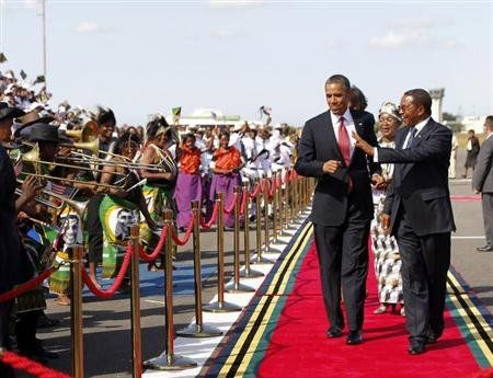U.S. President Barack Obama dances as a Tanzanian band plays during an official arrival ceremony at Julius Nyerere Airport in Dar es Salaam July 1, 2013.