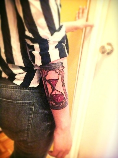 The Hour Glass from the Wizard of Oz.   Time eventually runs out, deary.  Done by Hector.  Born4Ink Bronx, NY