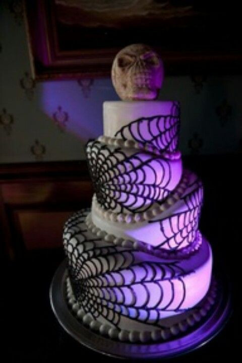 im really digging this cake laced with spider webs i would personally add - Halloween Wedding Cakes Pictures