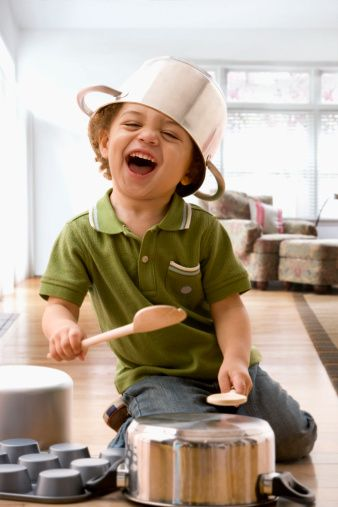 Boy wearing pots on head, banging on pots and pans with wooden spoons, as drums, drumming drummers, young children, Singing academy for kids in Balwyn - http://www.extraordinarykids.com.au