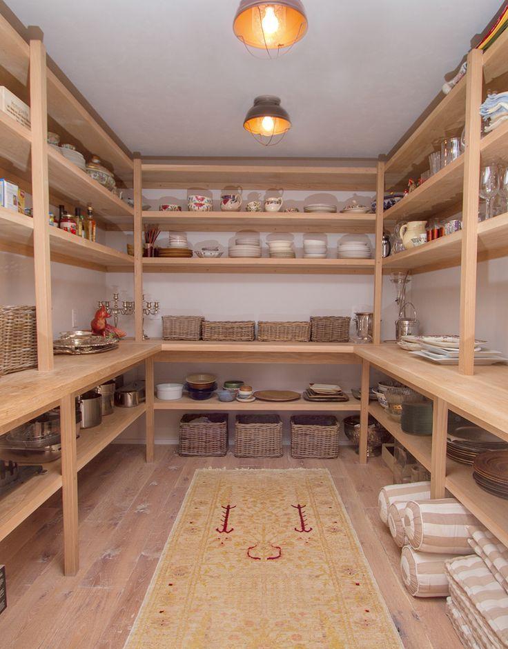 Interesting pantry shelf construction. Larger shelves below practical bench; food storage shelves above.