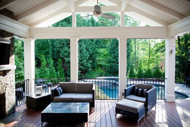 Covered deck with grill, fireplace, bar, entertainment area, and pool.