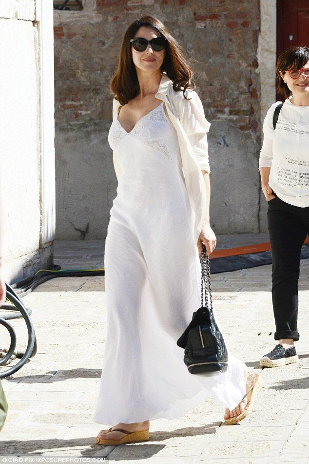 Looking all-white: The 51-year-old actress looked a vision in white as she stepped out in an ethereal white maxi dress that swirled around her feet in a pool of linen material