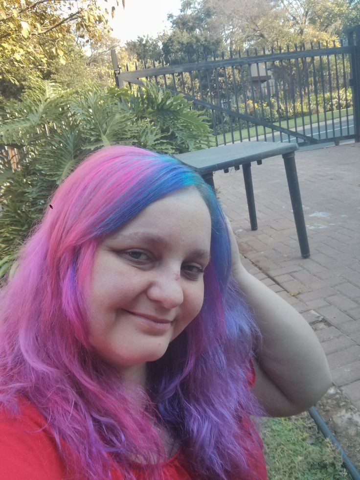 Applied rockabilly blue to the unbleached roots while waiting for the pink to fade.