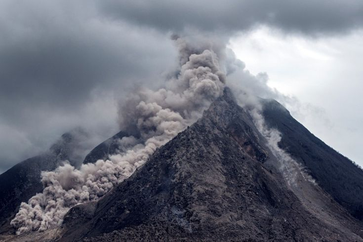 An Indonesian volcano erupted Monday (Feb 19), sending a huge column of ash and smoke a few 5,000m into the air, leaving neighborhood villages coated in particles and officials scrambling at hand out face mask to residents.