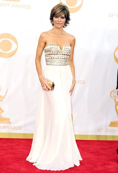 Lisa Rinna, on hand to support husband Harry Hamlin (of Mad Men), wore a strapless gold and white gown at the 2013 Emmys.