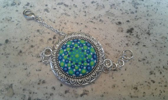 Check out this item in my Etsy shop https://www.etsy.com/listing/458770510/glow-in-the-dark-dotillism-art-bracelet