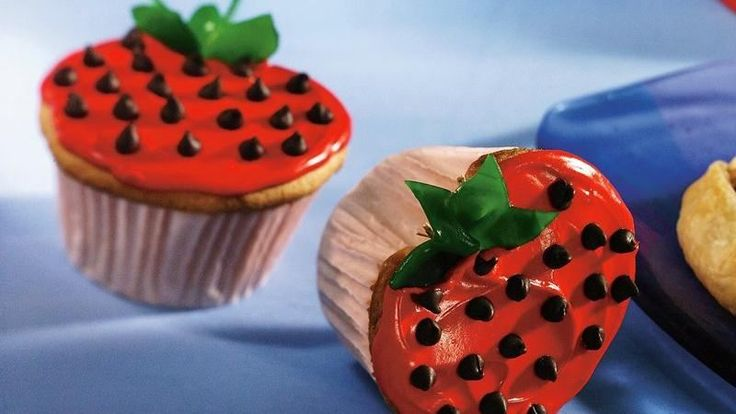 Enjoy these delicious strawberry-shaped cupcakes made in a decorative way using cake mix, frosting and fruit snacks--perfect for an anytime dessert.