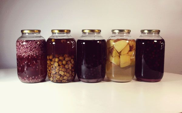 homemade liquer.   pomegranate, wild pear, blackberry, quince and blackthorn (sloe) in jars for at least 40 days.