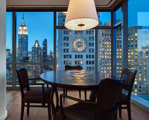 A 32nd floor apartment in Manhattan NY. [I love  the clock on the Met Life building becoming a wall clock in the dining space.]