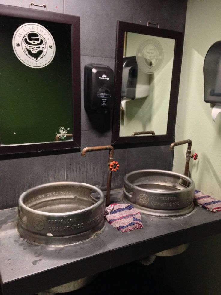 This Irish pub's bathroom sinks are made from beer kegs. - Imgur